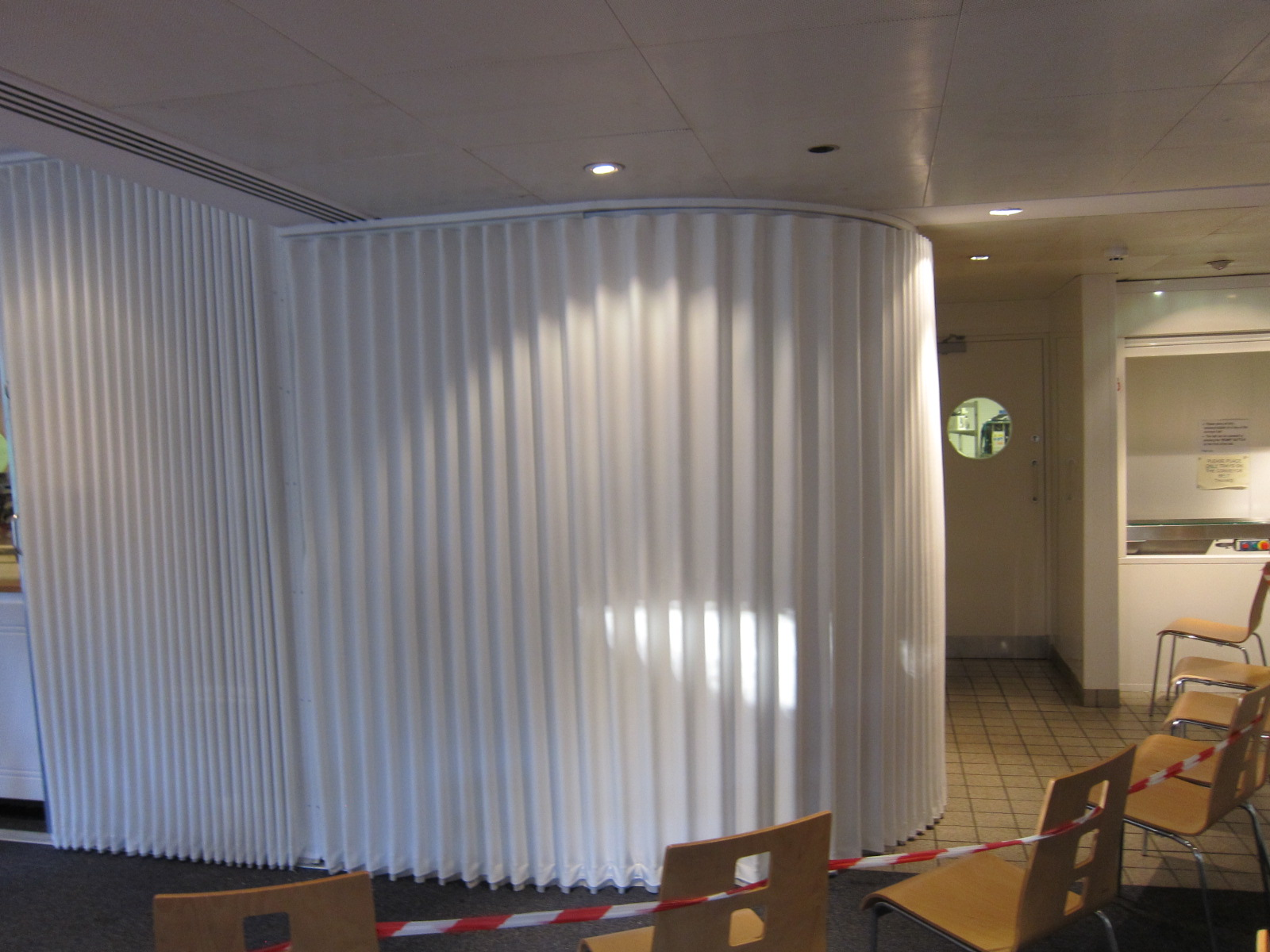 curved folding walls in white concertina fabric building additions