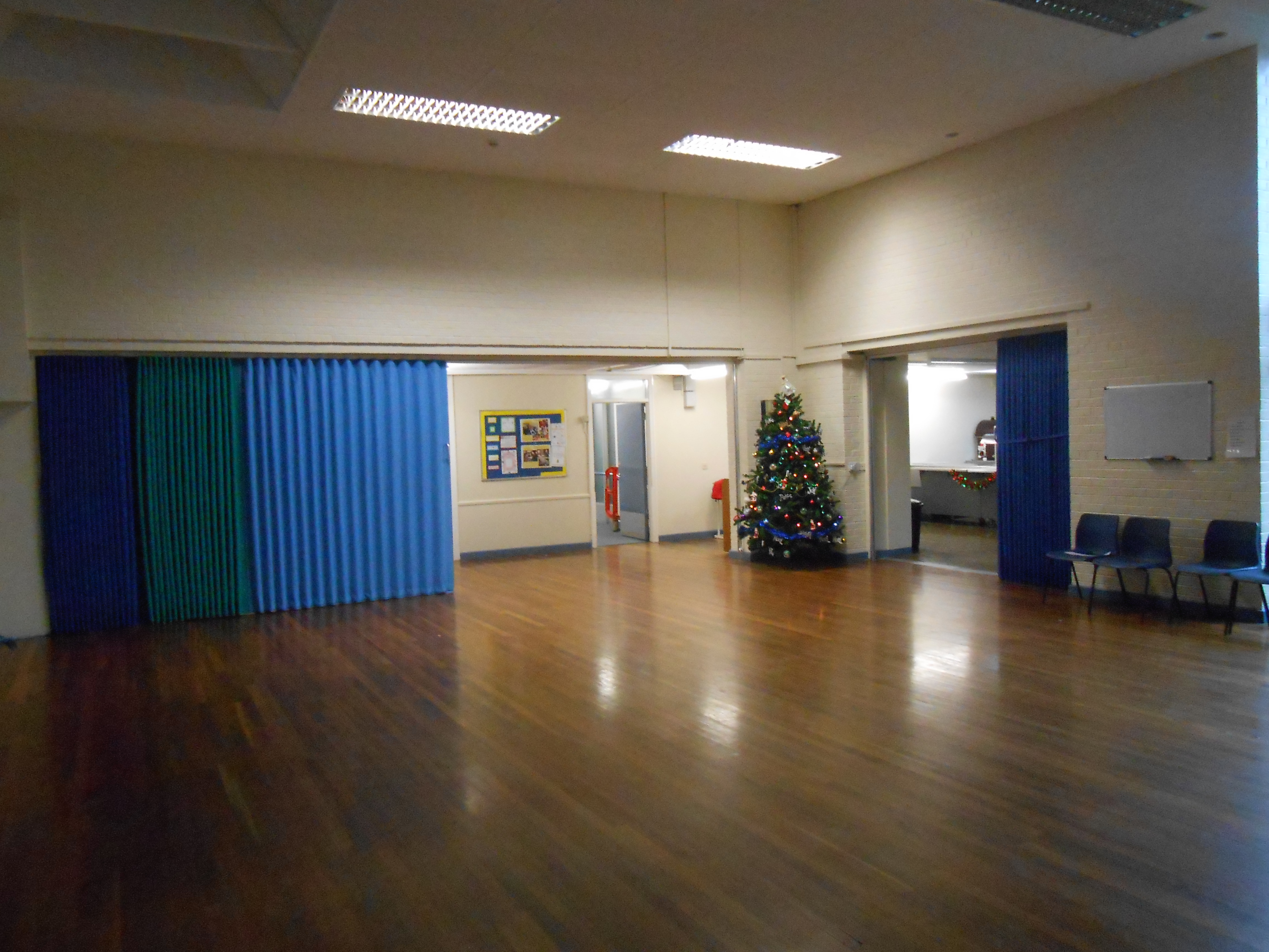blue folding concertina single leaf partition divider in a school