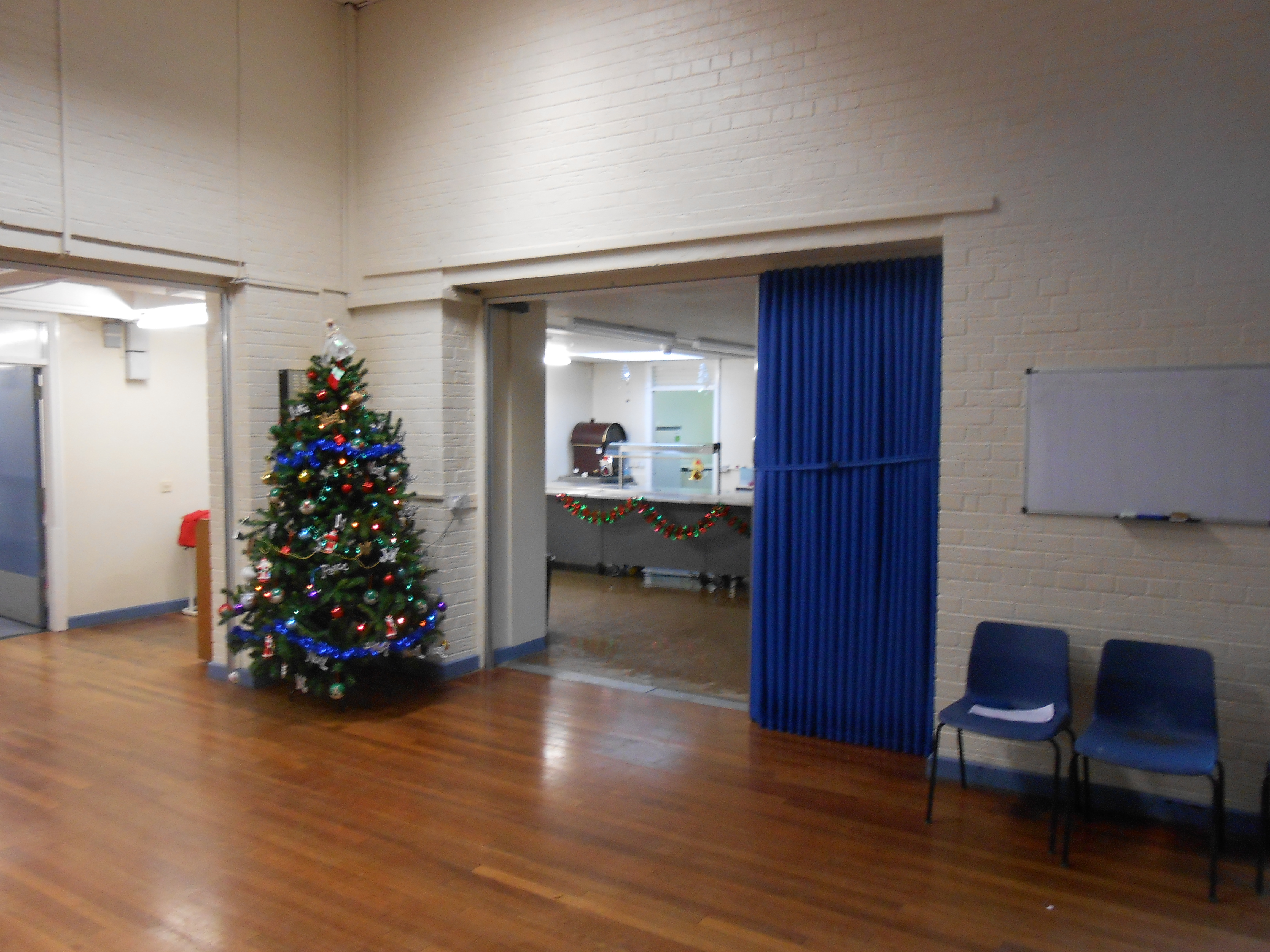 single leaf folding room divider in a school hall