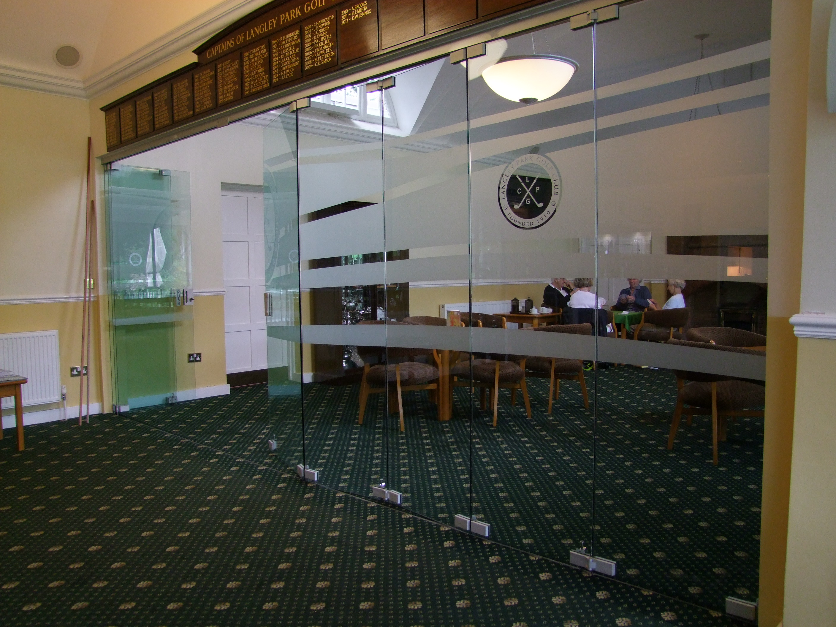 Purefold glass folding wall supplied by Building Additions