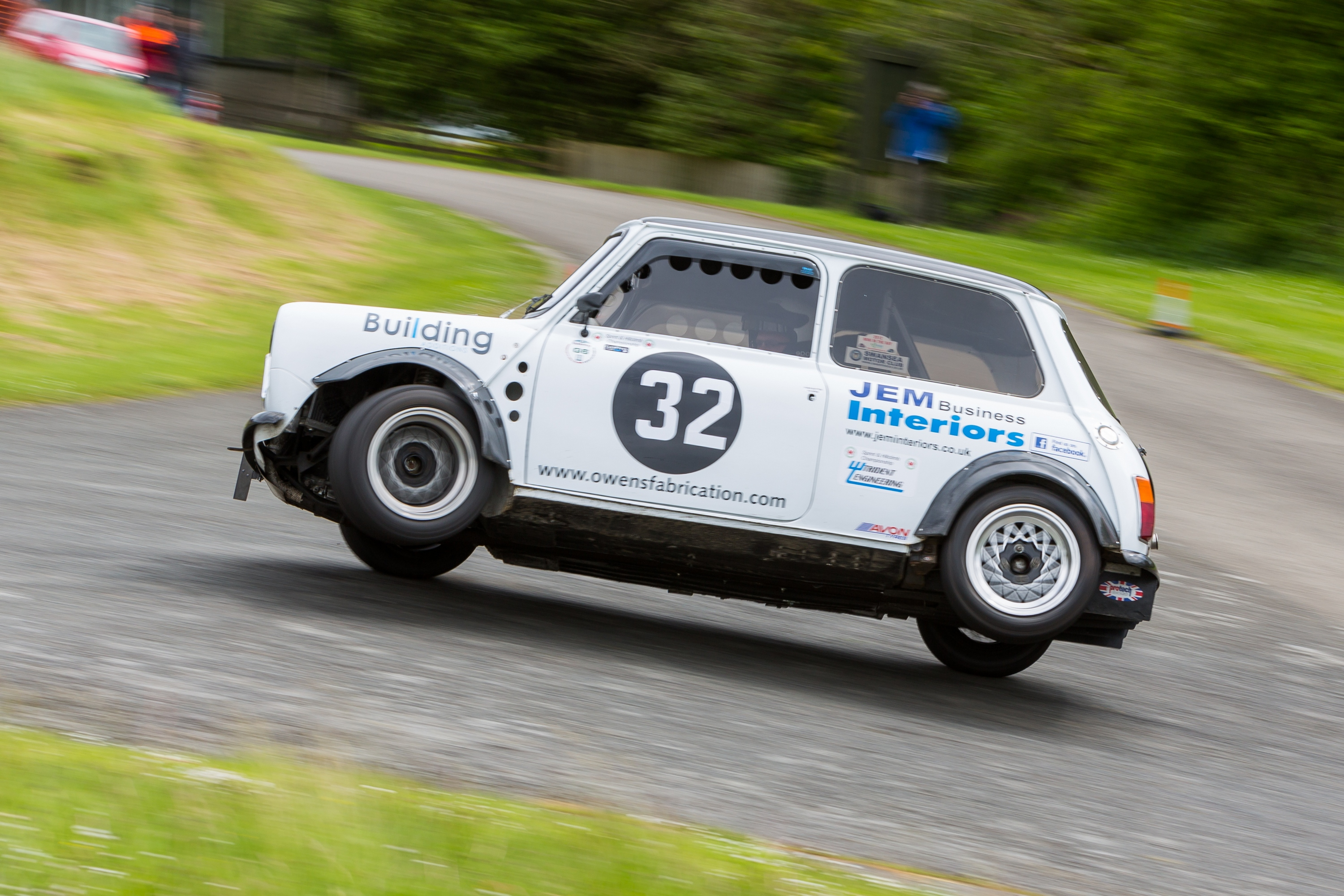 mini coop takes a corner on two wheels sponsored by Building Additions