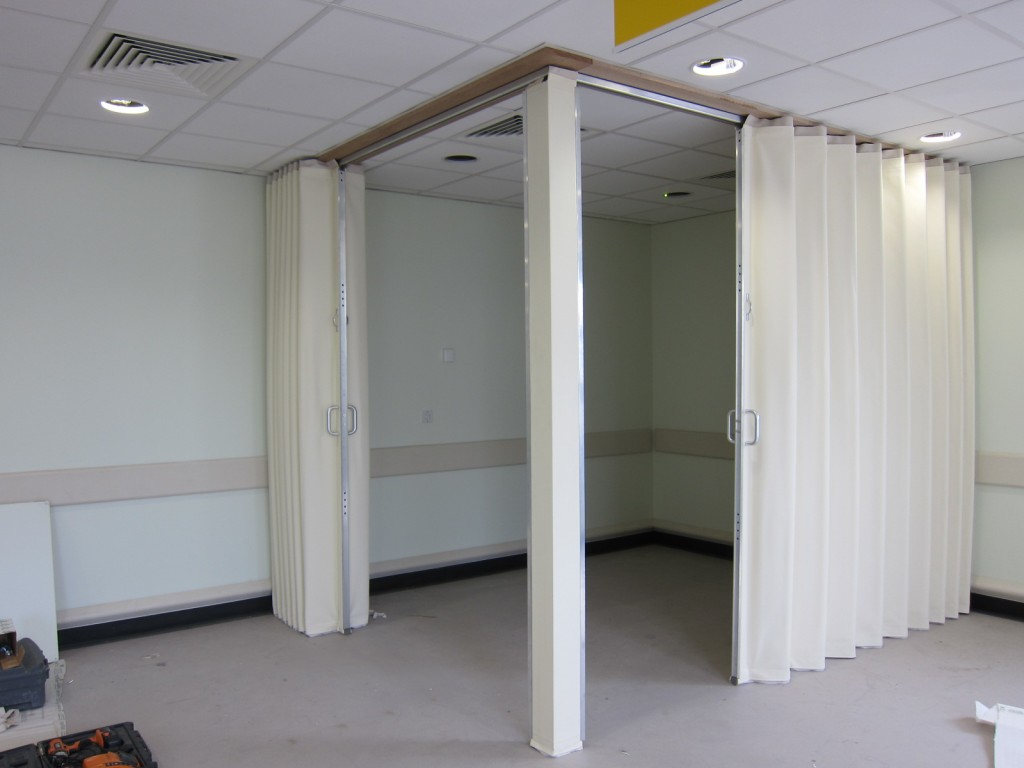 white concertina folding wall used to create a corner room Bristol - Building Additions