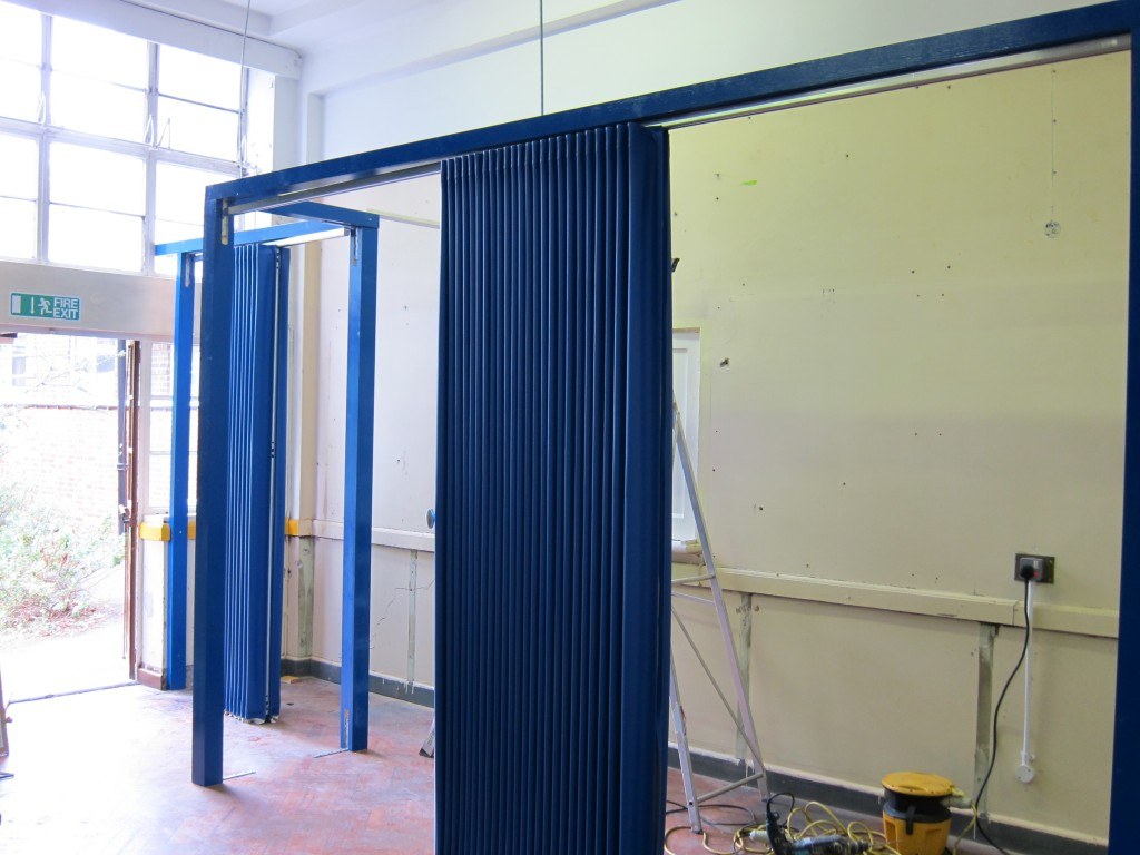 using blue folding walls to create temporary corridors in schools in Bristol - Building Additions