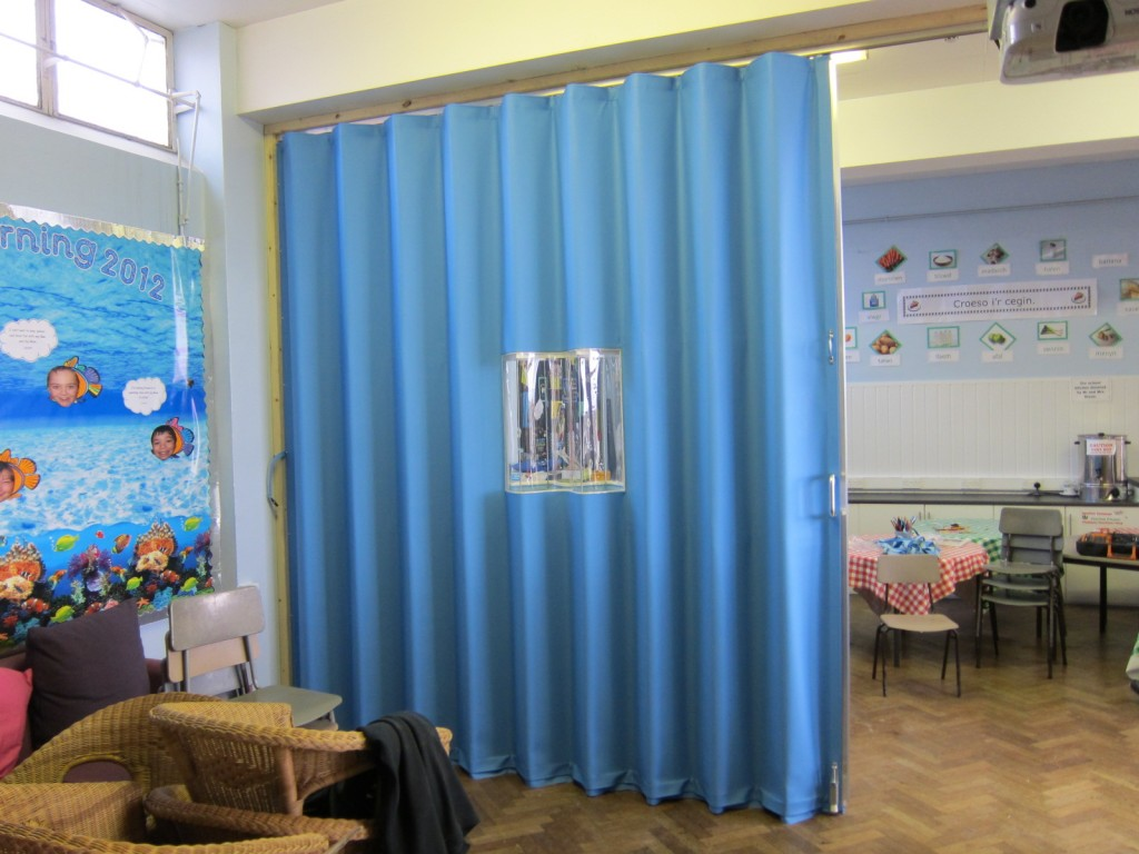 blue fabric folding walls with clear vision panel - Building Additions Bristol